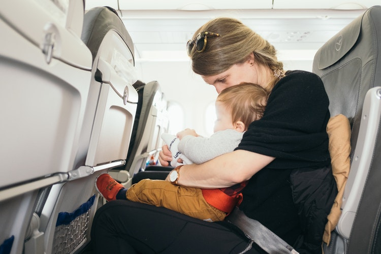 How To Actually Enjoy Flying With A Toddler On Your Lap
